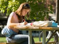 student at a picnic table