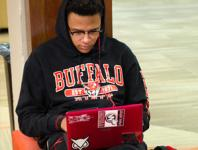 student sitting with laptop